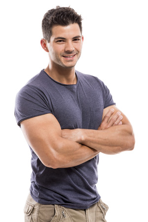 Portrait of a handsome and athletic latin man smiling with hands folded, isolated over a white background photo