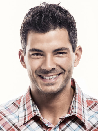 Portrait of a handsome latin man smiling, isolated over a white background photo