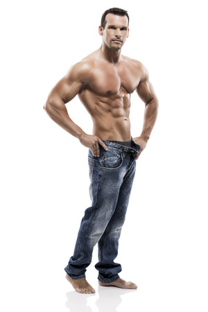 Muscle man posing in studio, isolated over a white background photo