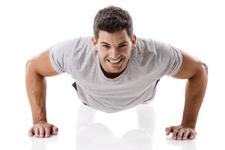 Man making pushups in studio, isolated over a white background