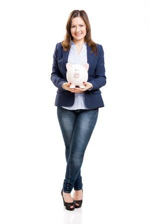 Business woman holding a piggy bank, isolated over white background photo