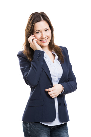 Business woman talking at phone, isolated over white background photo