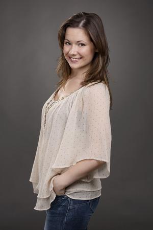 Beautiful and smiling woman posing in studio photo