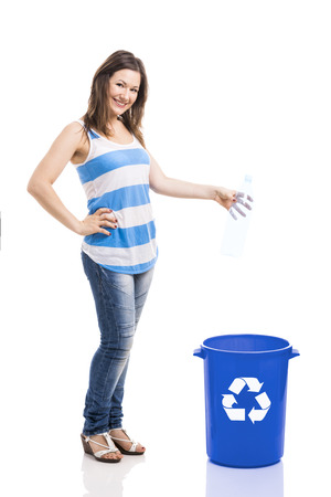 Beautiful young woman doing recycling, isolated over white background photo