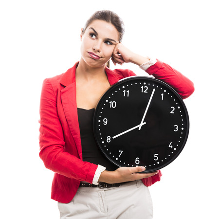 Bored business woman holding a big clock on the hands photo