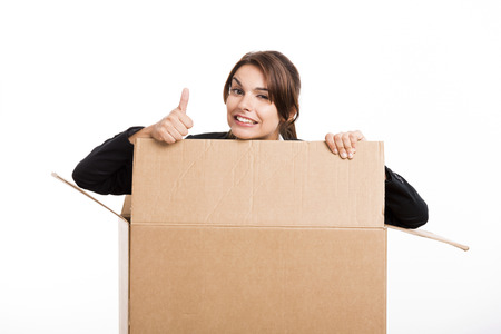 appear: Business woman appear inside a big card box with thumbs up, isolated over white background