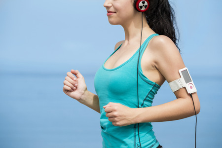 Crop view of a  beautiful young woman jogging  photo