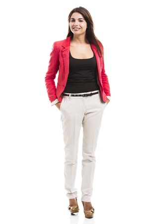 Modern business woman smiling and standing over a white background photo