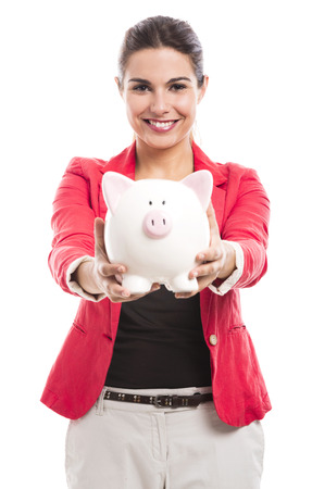 Business woman holding a piggy bank on the hands, isolated over a white background photo