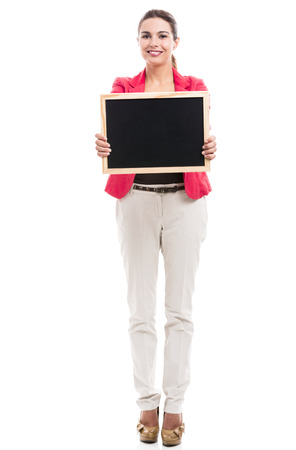 Business woman holding a shalk board on the hands, isolated over a white background (with copy space for designers) photo
