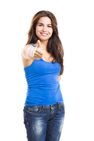 Beautiful and happy woman with thumbs up, isolated over a white background photo