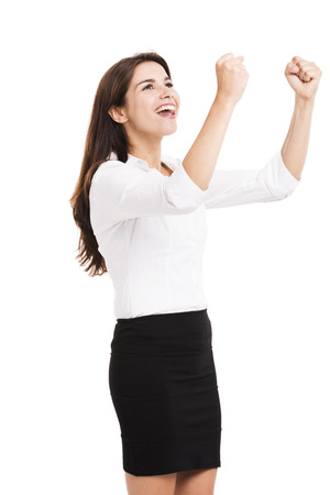Beautiful and happy hispanic business woman with arms up, isolated over a white background photo