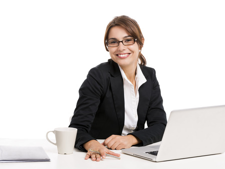Beautiful and happy hispanic business woman working in the office, isolated over a white background photo