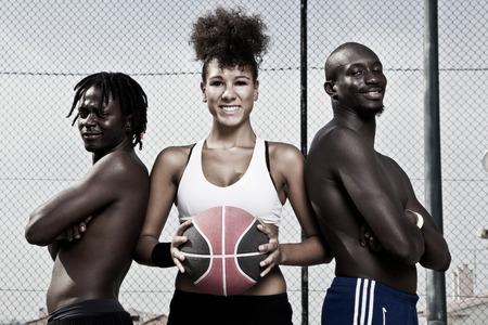 girl action: Group portrait of male and female street basket team