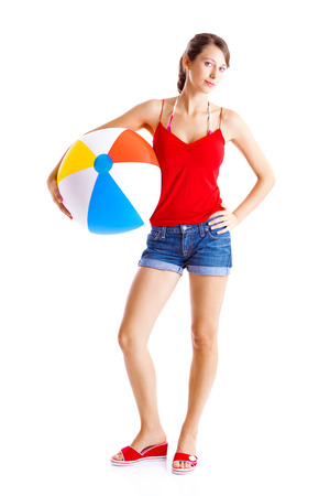 causal clothing: Beautiful young woman posing with a beach ball Stock Photo