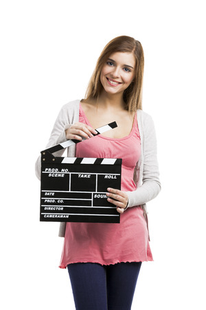 Beautiful blonde woman holding  a clapboard, isolated over white background photo