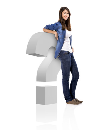 Beautiful woman standing over a interrogation symbol, isolated over a white background photo
