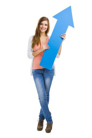Beautiful blonde woman holding a blue arrow photo