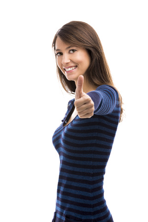 winning woman: Beautiful woman with thumbs up isolated over a white background Stock Photo