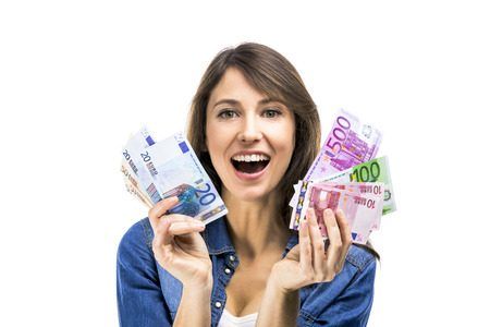 Beauitful woman holding some Euro currency notes, isolated over white background photo