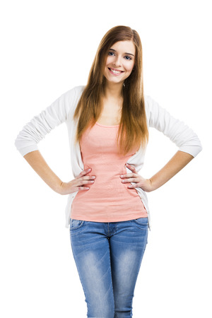 hands on hips: Beautiful blonde woman standing over a white background and smiling