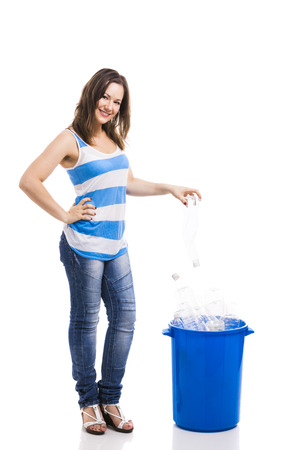 segregated: Beautiful young woman doing recycling, isolated over white background