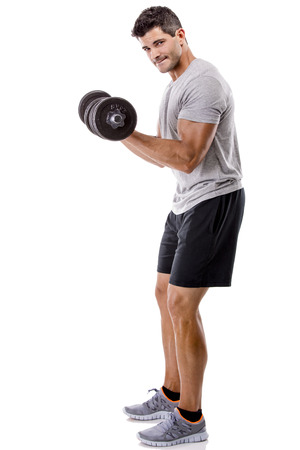 Portrait of a muscular man lifting weights, isolated over a white background photo
