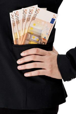 bolsa dinero: Mujer de negocios con billetes de euros en los bolsillos, aislados en un fondo blanco