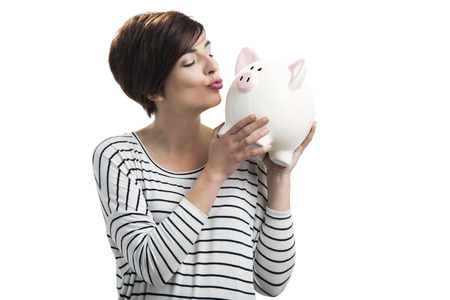 Beautiful happy woman with a piggybank, isolated over a white background Stock Photo - 27646900