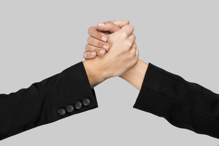 Greeting hands over a gray background Stock Photo - 27647002