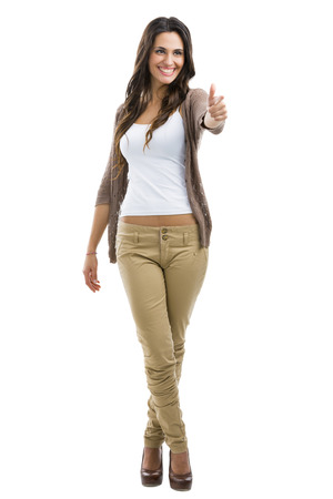 Beautiful woman  with thumbs up, isolated on white photo