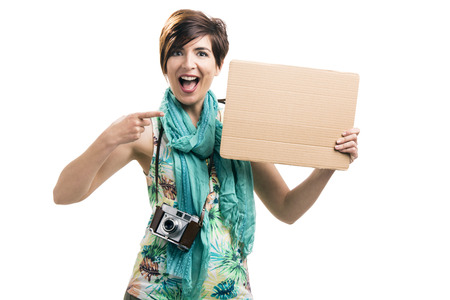 Beautiful woman holding a cardboard, isolated over a white background Stock Photo - 29541897