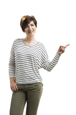 Beautiful woman pointing, isolated over a white background Stock Photo - 29541963