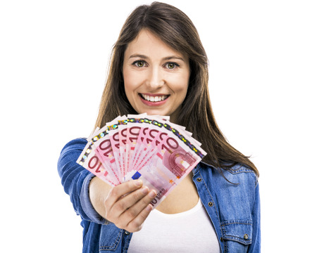 woman holding money: Beauitful woman holding some Euro currency notes, isolated over white background