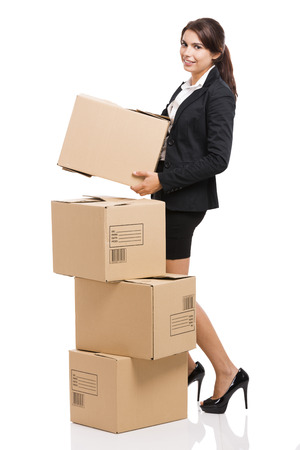 moving office: Business woman carrying card boxes, isolated over white background
