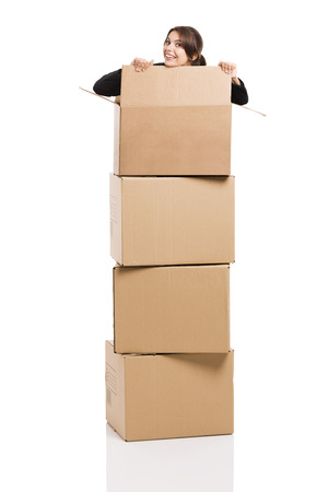 appear: Happy business woman appear inside big card boxes, isolated over white background