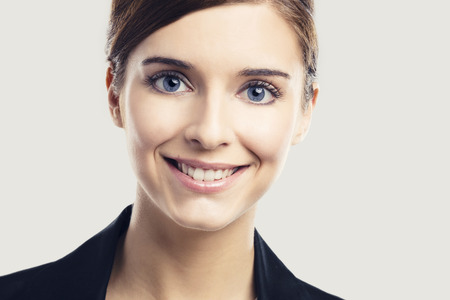Portrait of a beautiful blonde woman with blue eyes smiling photo