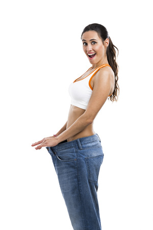 Woman with large jeans in dieting concept photo
