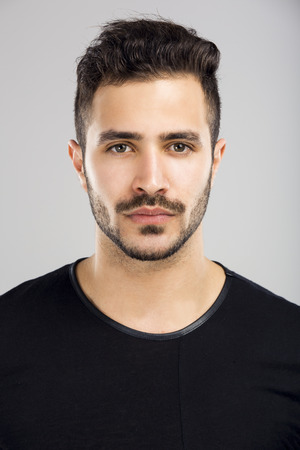 latin people: Portrait of a beautiful latin man with a serious expression