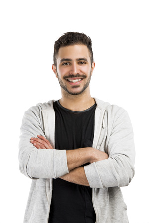 Beautiful and happy man smiling with hands folded photo