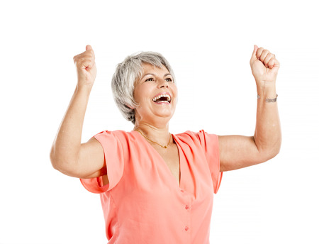 gaiety: Happy old woman with both arms on the air, isolated on a white background