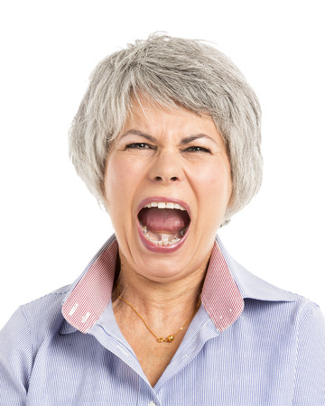 Portrait of a elderly woman with a yelling expression photo