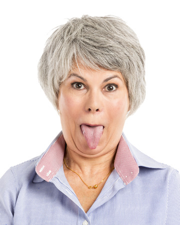Portrait of a elderly woman with a funny expression