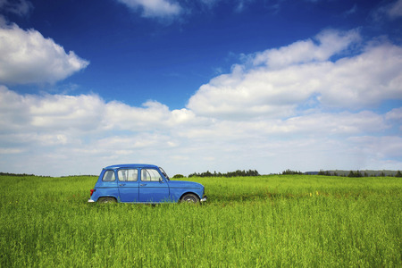 Beautiful old vintage car on a green meadow photo