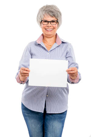 gaiety: Happy elderly woman holding a blank paper card with copy space for the designer Stock Photo