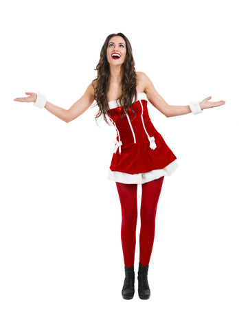 sexy santa claus: Beautiful and sexy woman wearing santa clause costume with arms open