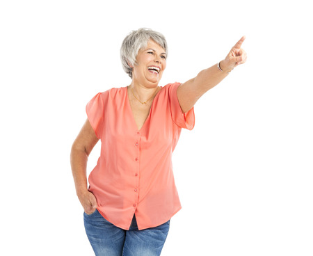 gaiety: Happy old woman pointing to something