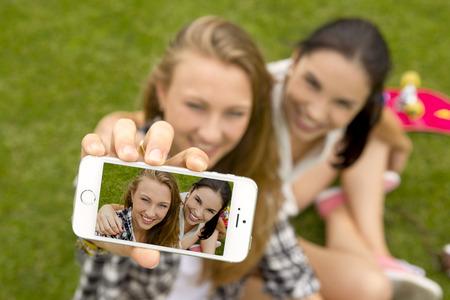 girl face: Best friends making a selfie Stock Photo