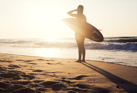 surf girl: Beautiful young girl in the beach with her surfboard