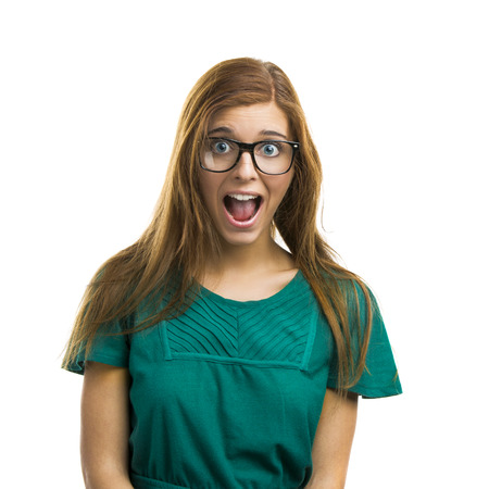 surprise face: Portrait of a beautiful girl with a surprised expression isolated on white background